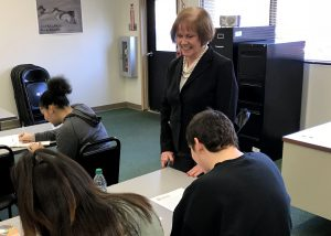 Mary Cahill talks to students in the classroom