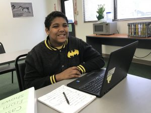 A student smiles in class.