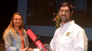 CTE Building Trades Student Taylor Vincent receiving Curtis Lumber Golden Hammer Award