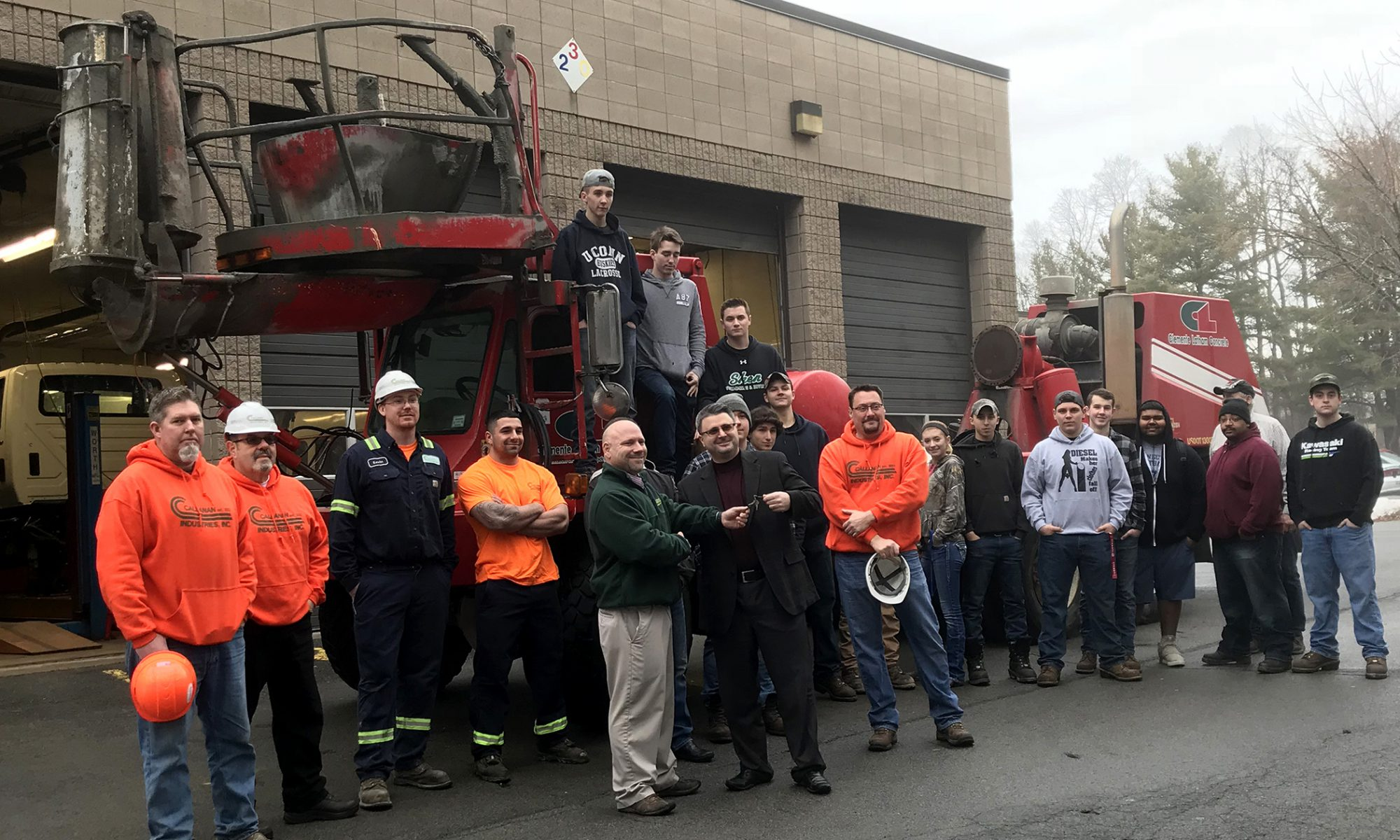 Large group of employers for Callahan Industries stand near a truck outside