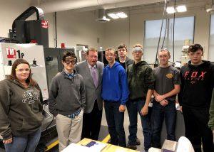Assemblyman Chris Tague and BOCES Manufacturing and Machining Technology students during a Manufacturing Day during a Manufacturing Day event at the Center for Advanced Technology at Mohonasen.