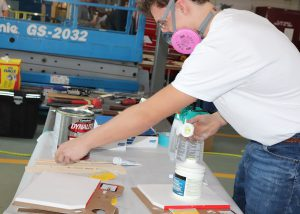 Capital Region BOCES Auto Body Student Tim DeCelle demonstrates his painting skills.