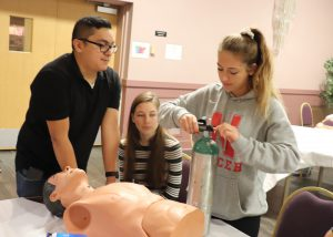 Students learn lifesaving skills with a teacher in a Capital Region BOCES New Visions Health Careers classroom.