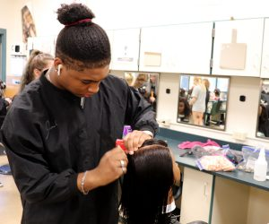 Josiah Courtwright of Niskayuna works on a mannequin head in a Capital Region BOCES cosmetology classroom.