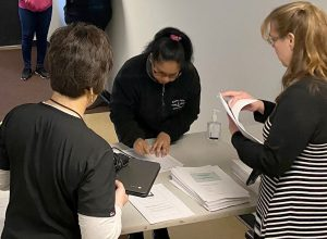 An Adult Nursing student receives a computer for online learning during the COVID-19 school closures.