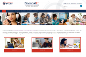 Photo of the homepage of the EssentialEd website showing students and teachers working together.