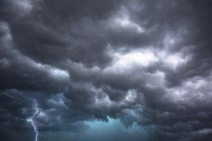 Dark storm clouds with lightening bolt